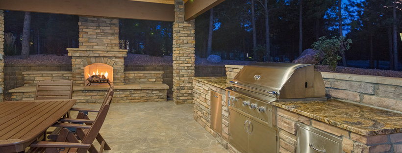 Patio kitchen with seating & fireplace